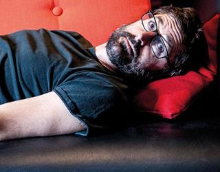 Louis Theroux laying down ()