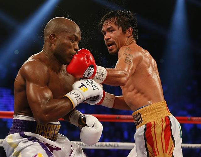 Manny Pacquiao punches Timothy Bradley ()
