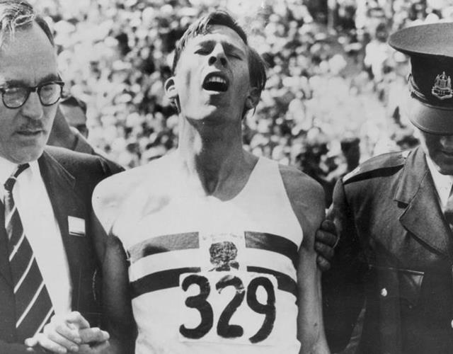 Roger Bannister exhausted after 4-minute mile ()