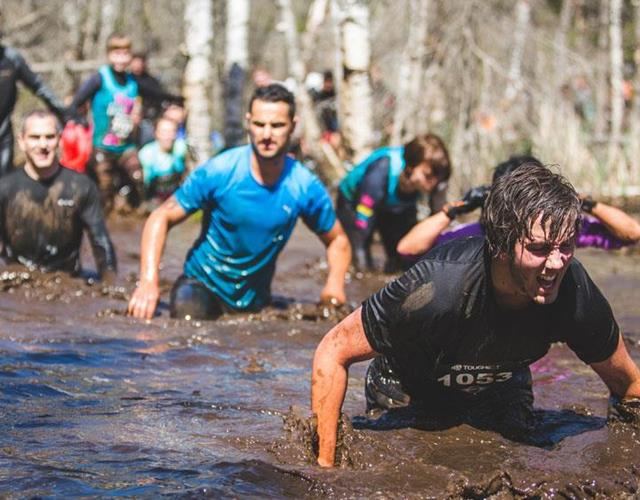 Wading through mud in an obstacle race  ()