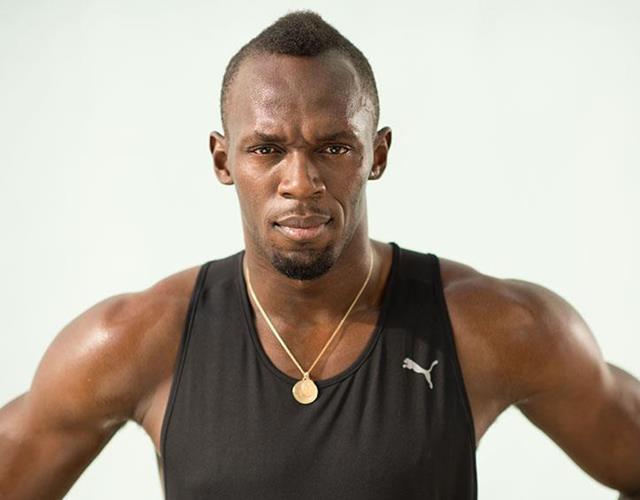 Usain Bolt hands on hips posing ()
