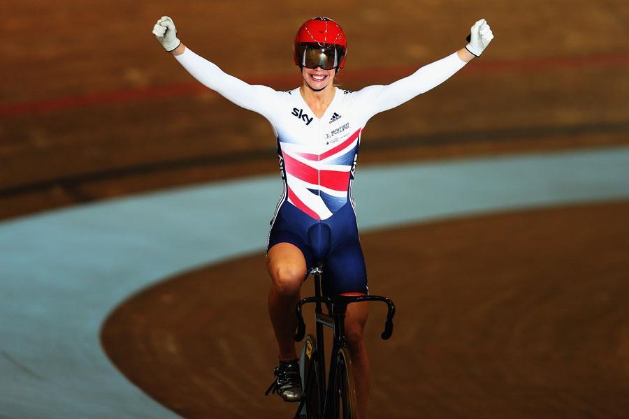 Becky James celebrates on her bike ()