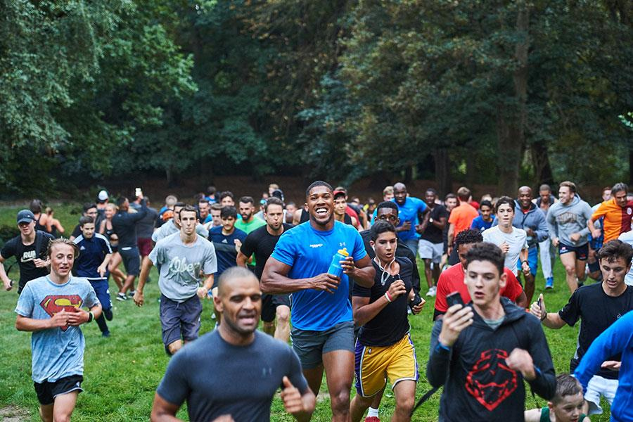 Anthony Joshua led crowds of 300 on a run on Hampstead Heath this evening as part of Lucozade Sport's new initiative to get more people moving. ()