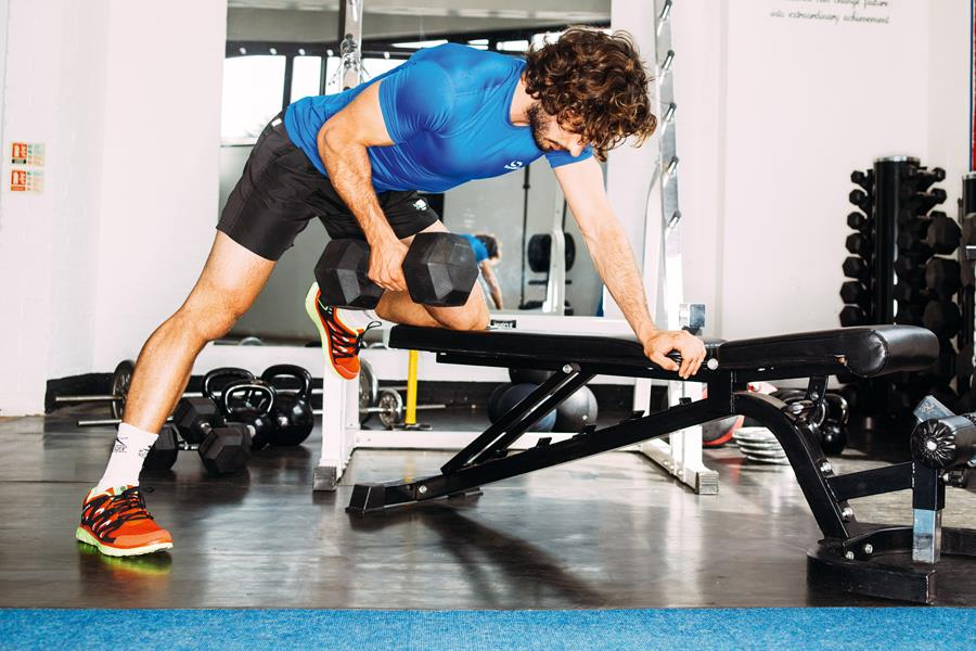 Joe Wicks single arm rows workout (Malcolm Griffiths)