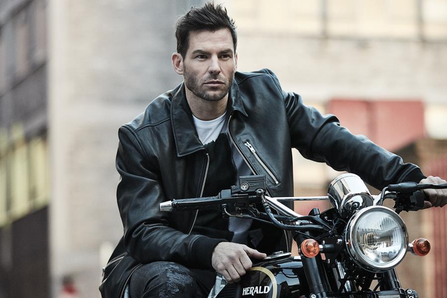 Gareth Seddon modelling a leather jacket on a motorbike ()