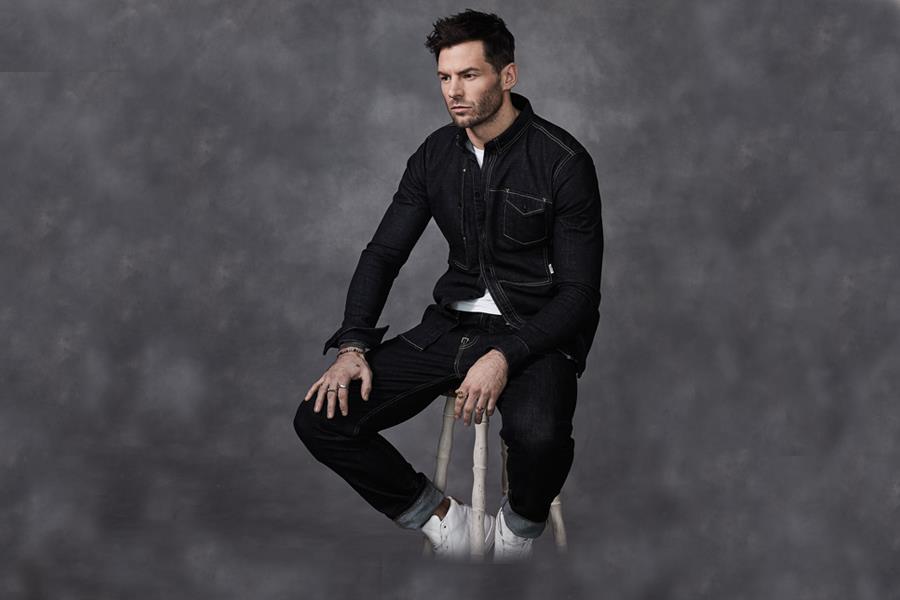 Gareth Seddon modelling on a stool ()