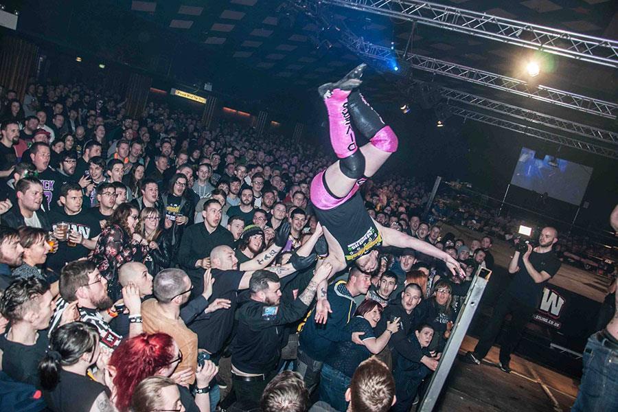 Insane championship wrestling dive into crowd ()