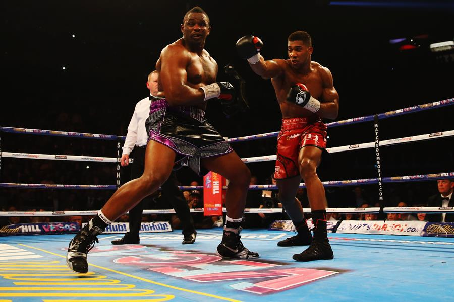Anthony Joshua lands a punch on Dillian Whyte (Getty)