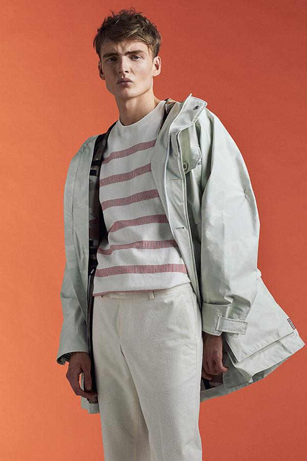 FS Magazine spring outwear fashion shoot. Lacoste sweater and Hunter Raincoat  ()