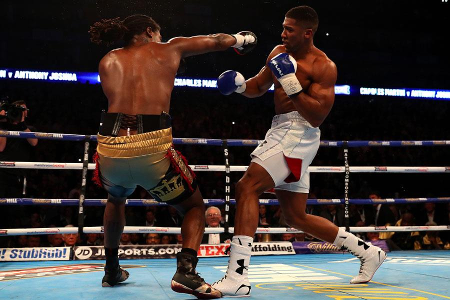 Anthony Joshua slips a punch from Charles Martin (Getty)