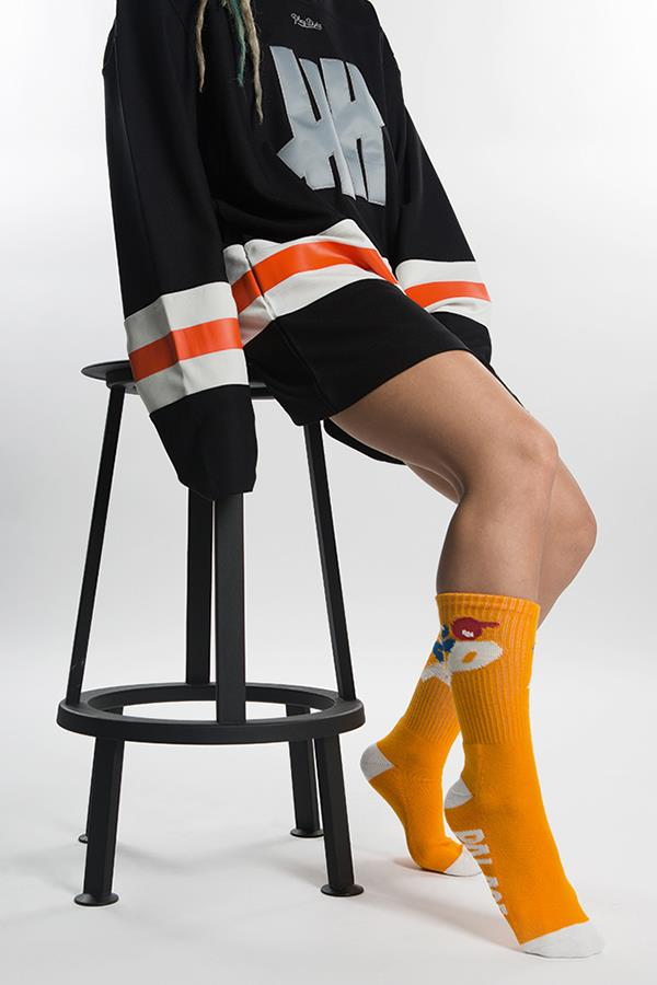 Cici Cavanagh wearing Undefeated jumper and Palace socks for FS magazine ()