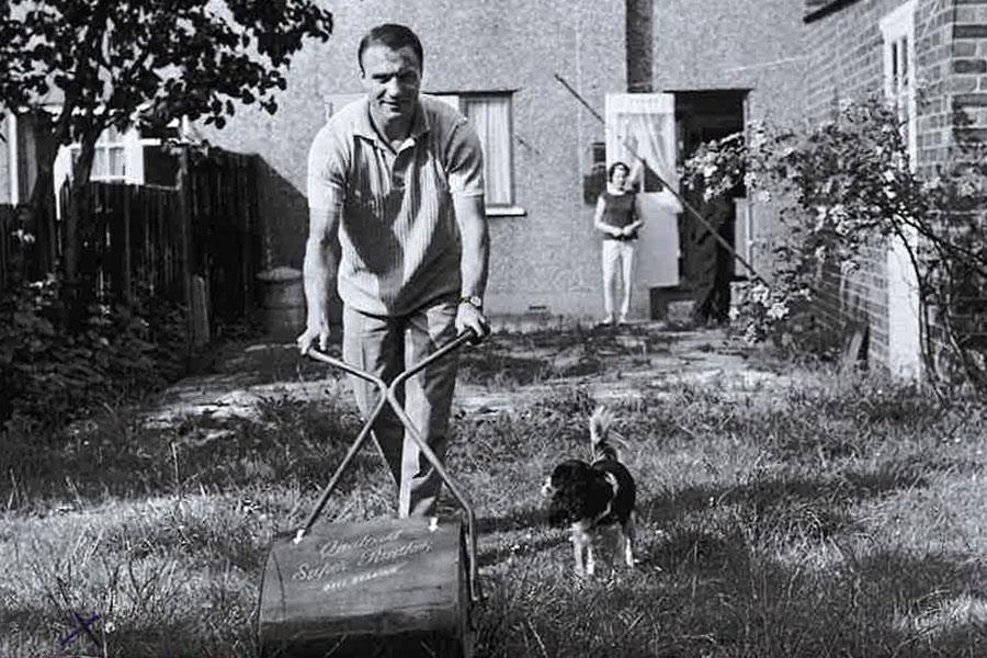 George Cohen mows his lawn ()