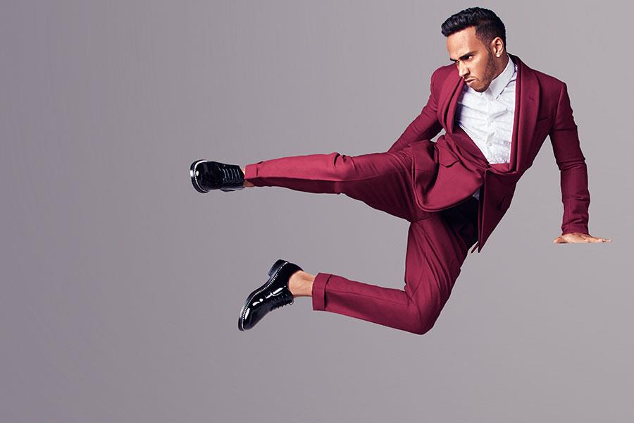 Lewis Hamilton flying kick in a suit for fashion photoshoot ()