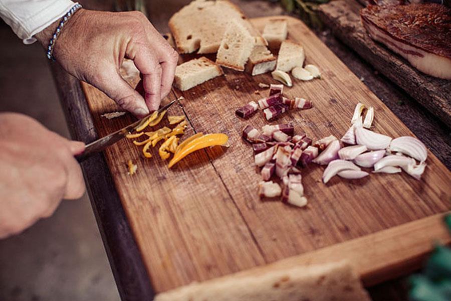 Food being cut on chopping board (Alamy)