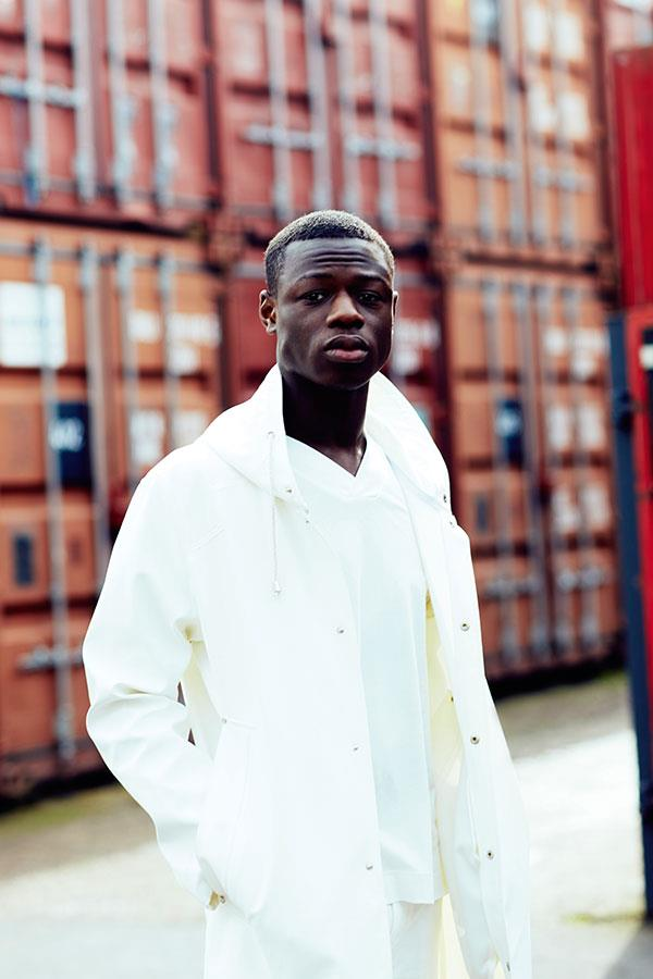 J Hus in white stutterheim jacket for FS magazine photoshoot ()