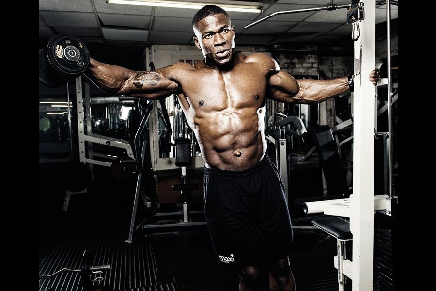 Wole Adesemoye Leaning dumbell lateral press (Tom Miles)