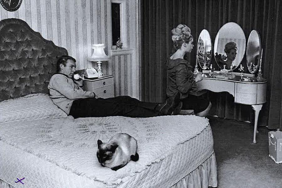Bobby More on a bed with Tina ()