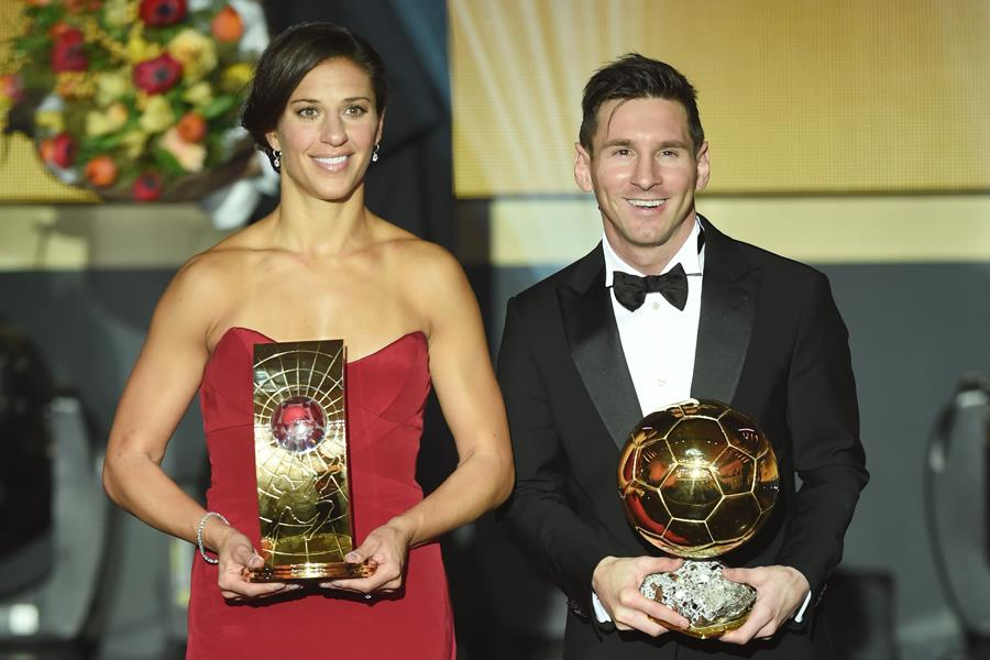 Carli LLoyd with her Ballon D'or with Lionel Messi (Getty Images)