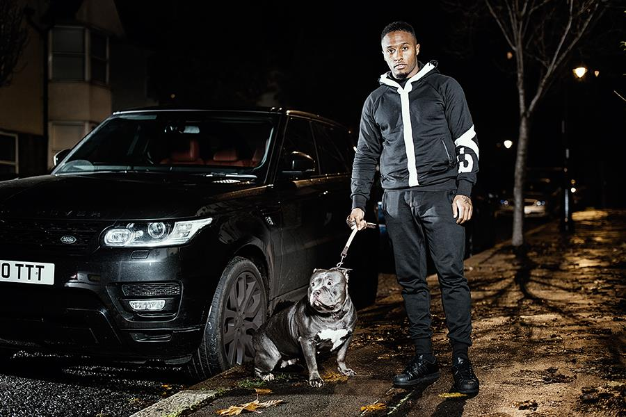 Callum Harriott with his dog and car in FS mag ()
