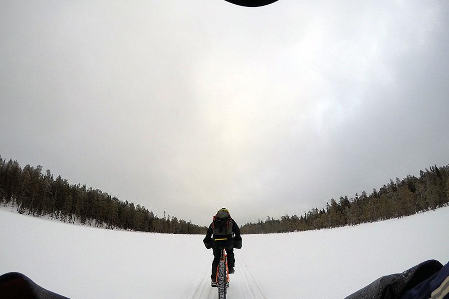 Fat biking through snow and forest in Finland ()