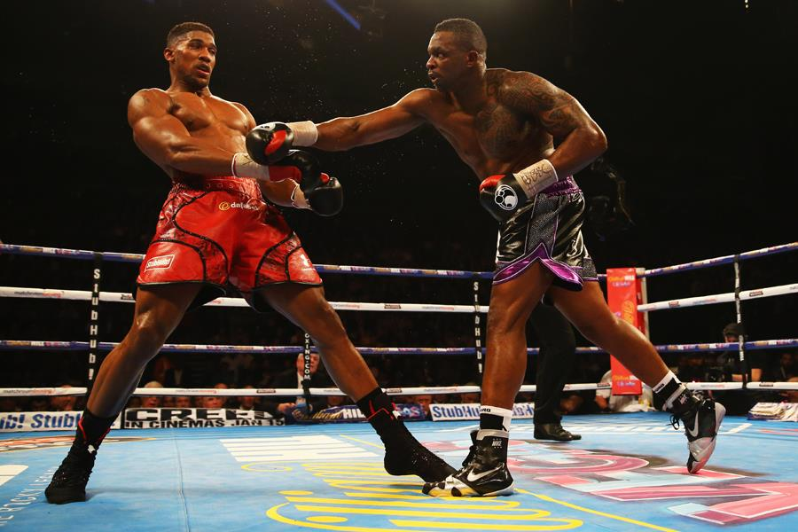 Anthony Joshua slips a punch from Dillian Whyte (Getty)