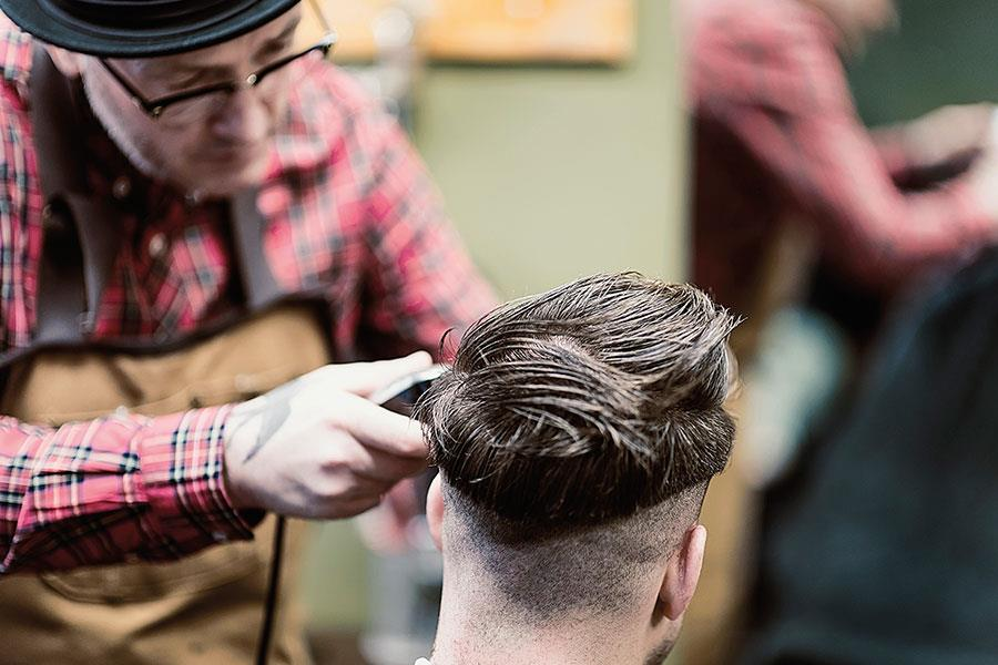 Rocket Barbers in peckham. Barber shaving hair in FS magazine shoot ()