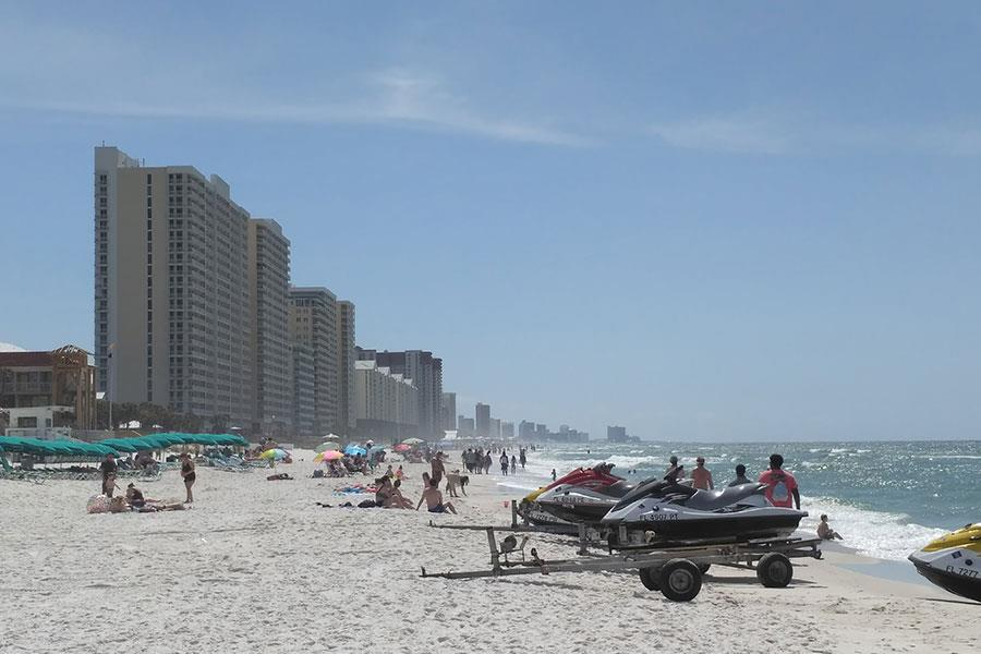 Beach with jet skis and skyscrapers in the background. USA  (Seren Rumjancevs)