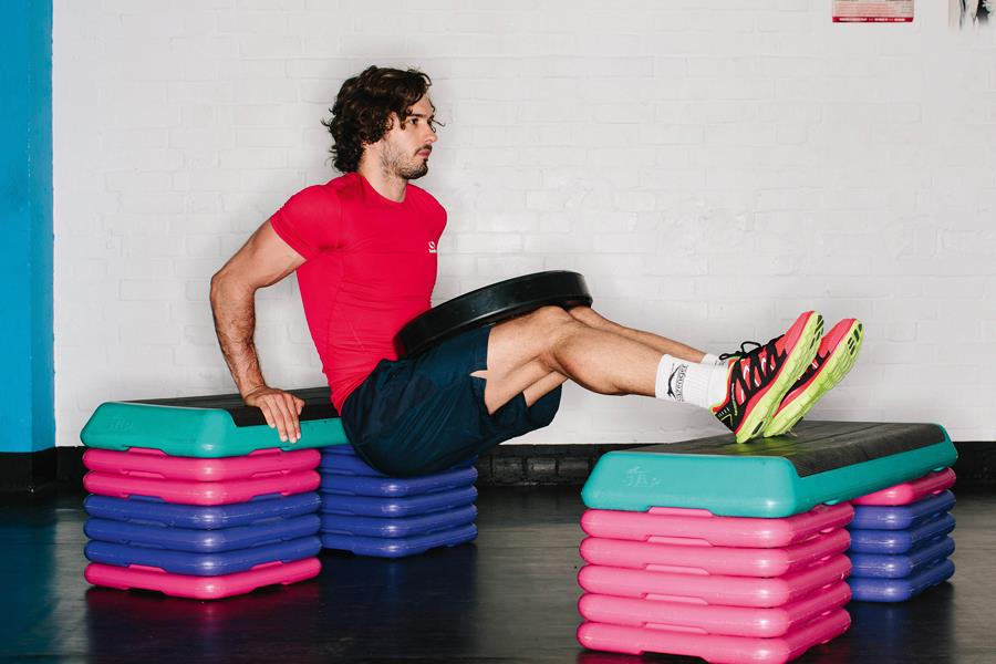 Joe Wicks the body coach weighted bench dips ()