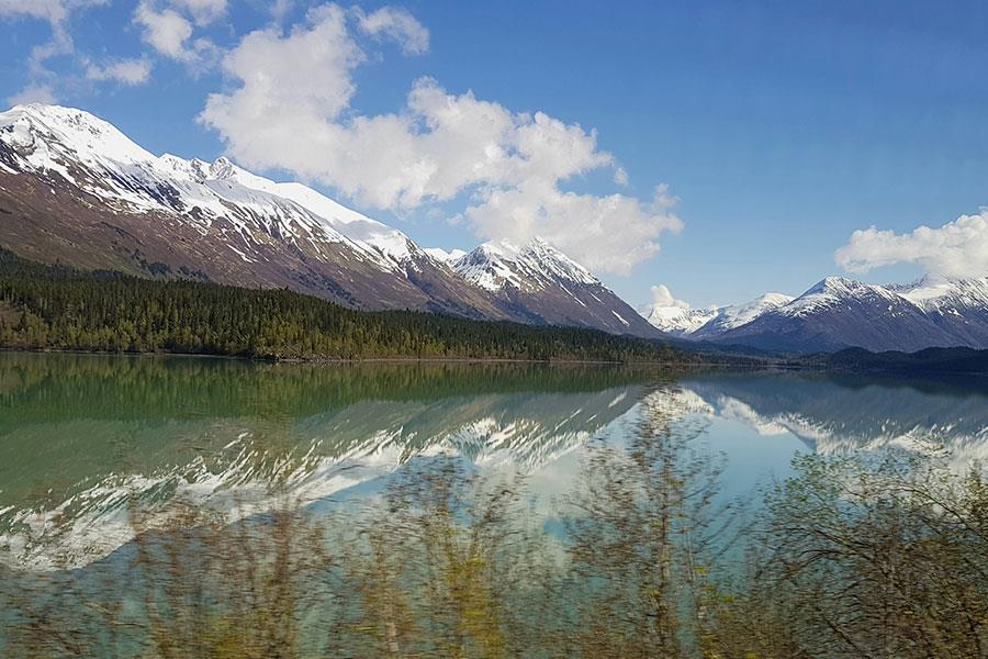 Mountains reflected in lake in Alaska ()