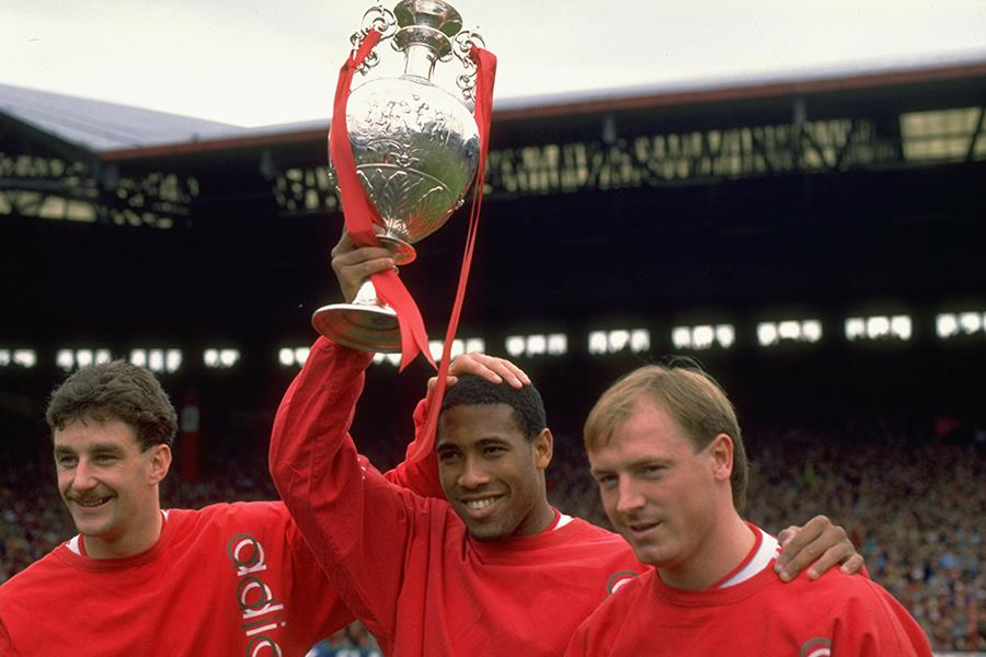 John Aldrige, John Barnes and Steve McMahon of Liverpool hold the League Champions trophy aloft (Getty Images)