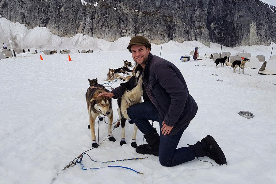 Petting Alaskan Huskies at a musher's camp on Norris Glacier ()