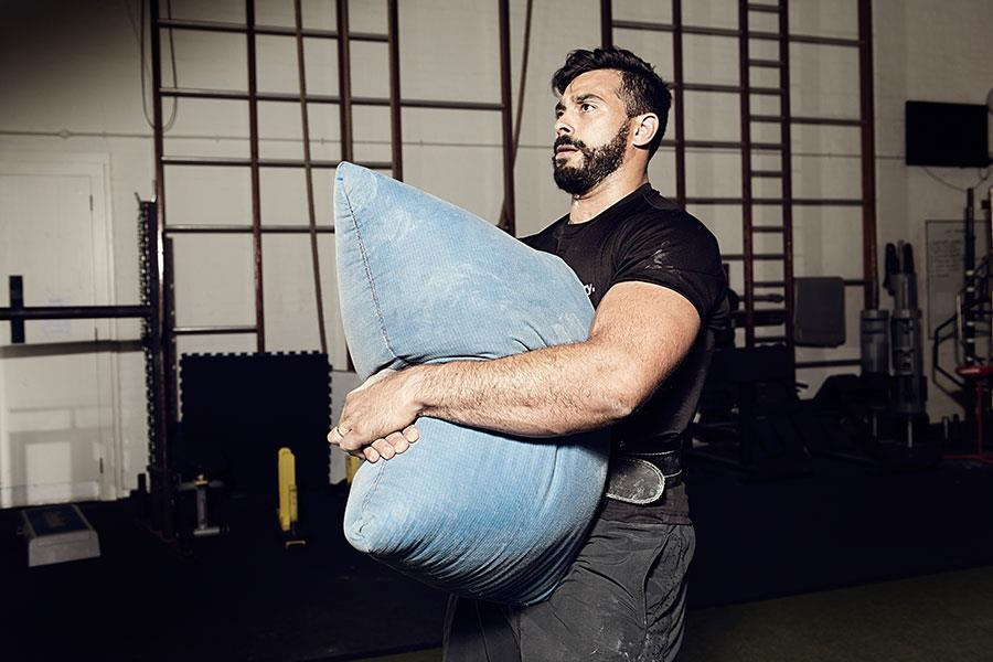 Sandbag carries FS magazine strongman workout ()