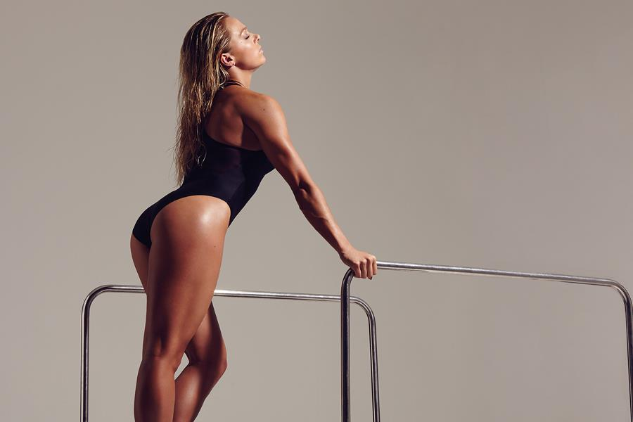 Tonia Couch posing in black swimsuit for photoshoot ()