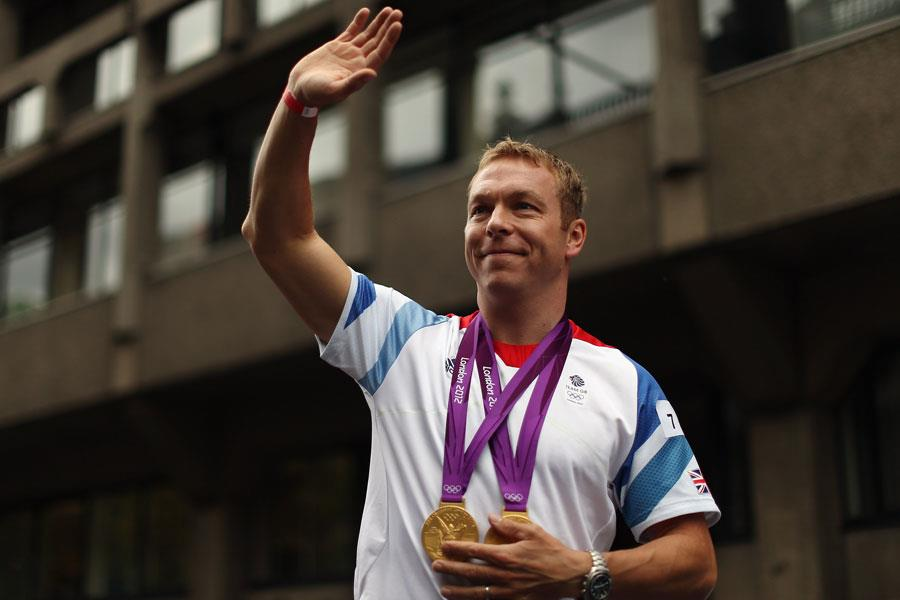 Sir Chris Hoy waves with two gold medals  (Getty)