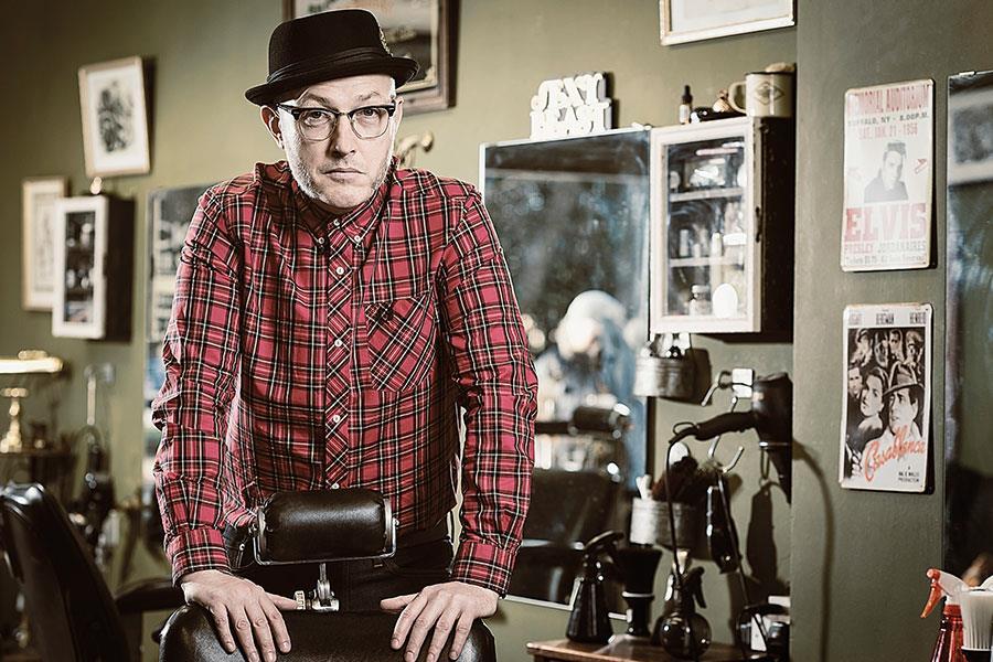 Rocket Barbers in peckham. Spencer Holmans poses for FS magazine photoshoot ()