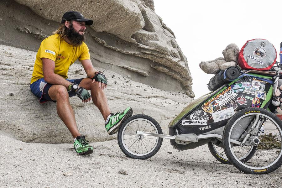 Jamie Ramsay sits on a rock during his 472-day marathon ()